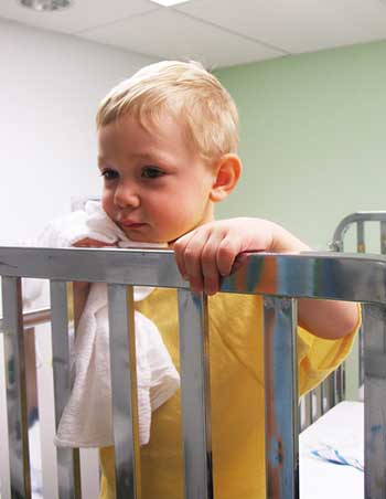 baby standing in the crib